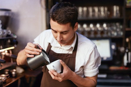 Barista Preparing Coffee In Cup At Cafe