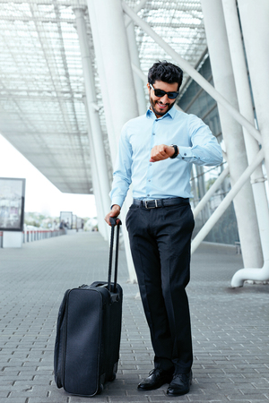 Business Trip. Man Traveling With Case At Airport Stock Photo - 106992740