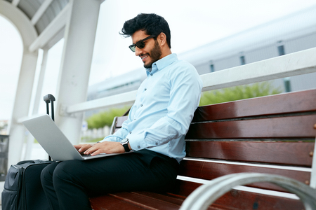 Business Man Work On Laptop Outdoors Stock Photo