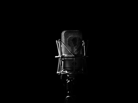 Studio Music Microphone Close Up In Sound Recording Studio On Black Background. Professional Condenser Microphone. High Resolution
