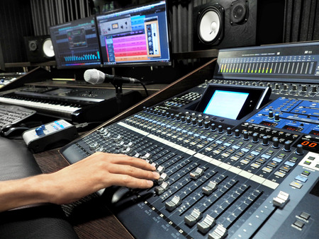 Sound Recording Studio With Professional Music Recording Equipment, Mixer Control Panel And Computer Monitors. High Resolution Stock Photo