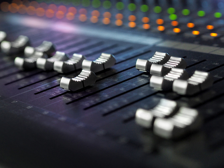 Sound Recording Studio Mixing Desk Closeup. Music Mixer Control Panel With Colorful Lights. High Resolution Stock Photo