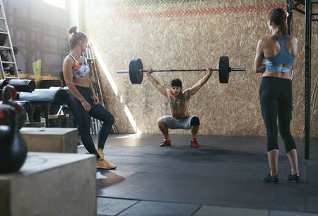 Sport. Crossfit Athletes At Workout Gym