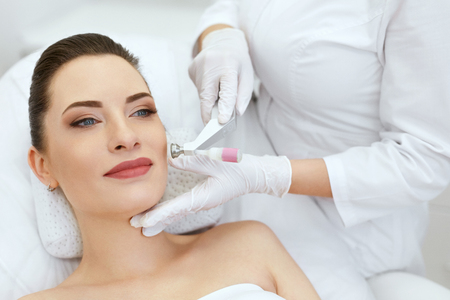 Beauty Clinic. Woman Doing Face Skin Cryo Oxygen Treatment At Cosmetology Center. High Resolution Stock Photo