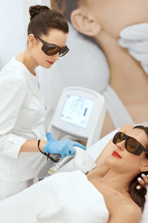 Laser Epilation. Woman On Laser Underarm Hair Removal Procedure. Beautician Removing Armpit Hair At Cosmetology Clinic. High Resolution