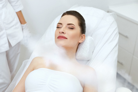 Cosmetology. Woman At Facial Oxygen Cryotherapy At Beauty Centre. Cryo Treatment On Face. High Resolution Фото со стока