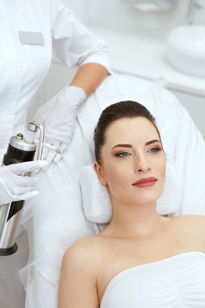 Cosmetology. Woman At Facial Oxygen Cryotherapy At Beauty Centre. Cryo Treatment On Face. High Resolution Stock Photo
