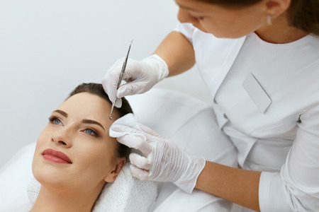 Face Skin Cleansing. Woman On Facial Mechanical Cleaning. Cosmetologist Doing Procedure At Cosmetology Clinic For Young Female. High Resolution
