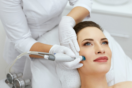 Face Skin Care. Closeup Of Woman Face Cleansing At Cosmetology. Beauty Procedure For Deep Skin Cleansing With Hydro Vacuum. High Resolution