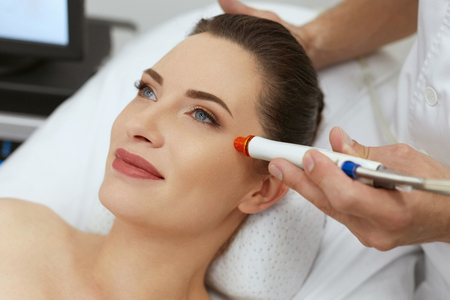 Face Skin Treatment. Woman At Anti-Acne Therapy At Salon Closeup. Female Doing Skin Dermabrasion Procedure At Clinic. High Resolution Stock Photo - 108158034