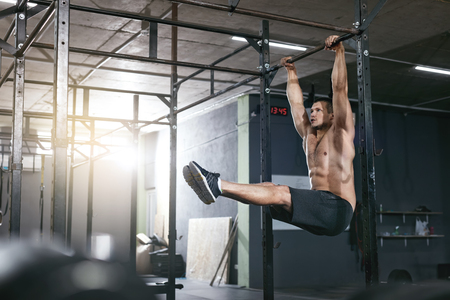 Training. Sports Man Doing Pull Ups Exercise On Sport Rack, Exercising Pull Up At Workout Gym. High Resolution