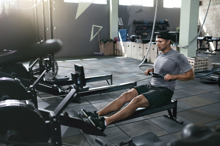 Functional Training. Man Doing Exercise On Rowing Machine At Gym, Sport Male Athlete Workout. High Resolution 写真素材 - 108431984