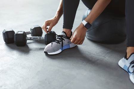 Sports Shoes. Woman Hands Tying Shoelaces On Fashion Sneakers, Closeup Of Training Footwear. High Resolution