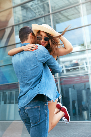 Couple Meet After Long Time. Happy People Hugging Near Airport. Loving Couple Embracing Outdoors. High Resolution Stock Photo