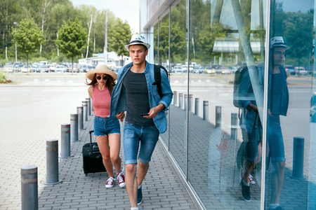 Late For Flight. Couple Running To Catch Plane. People Travel On Vacations. High Resolution Stockfoto