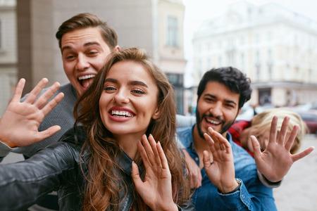 People Using Phone Taking Photos On Street, Video Calling. Happy Friends Having Fun Outdoors. High Resolution Zdjęcie Seryjne