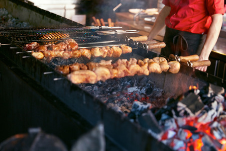 Grilling Meat On Skewers. Barbecue Meat Pieces Cooking On Grill In Restaurant. High Resolution