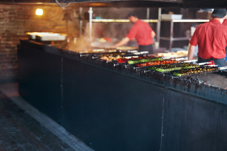 Cooking Barbecue In Restaurant. Vegetables Grilling On Grill At Kitchen. High Resolution