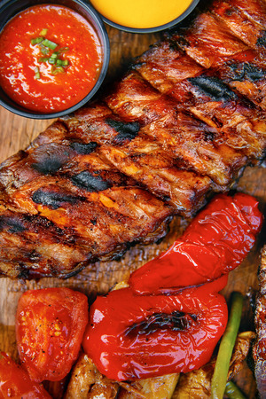 Food. Grilled Meat And Vegetables With Sauce Closeup. Grilles Pork Ribs In Restaurant. High Resolution