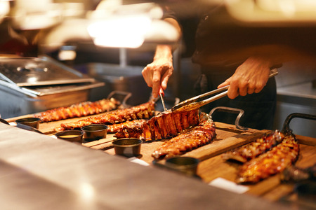 Food In Restaurant. Barbecue Pork Ribs In Grill Bar. Spareribs On Wooden Tray In Restaurant Kitchen. High Resolution