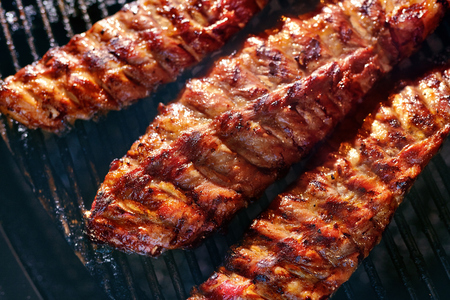 Grill Meat Food. Pork Ribs Grilling Closeup. Cooking Spareribs On Barbecue. High Resolution