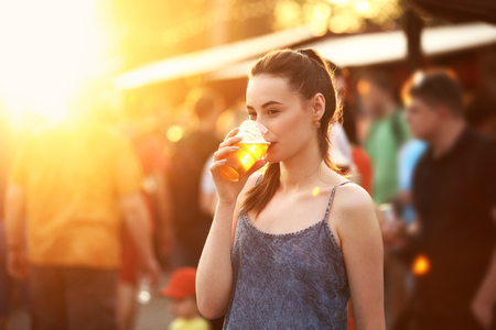 Woman Drinking Beer Outdoors. Attractive Girl With Beer Glass On Festival. High Resolution