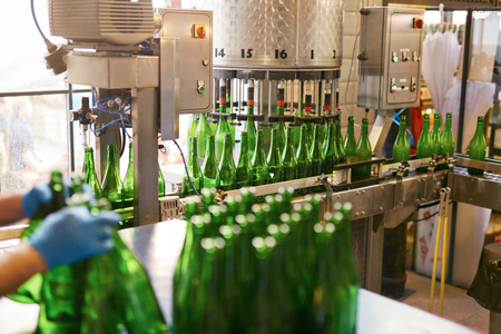 Craft Beer Brewing Production At Brewery. Distillation Bottles For Beer Bottling. High Resolution 写真素材