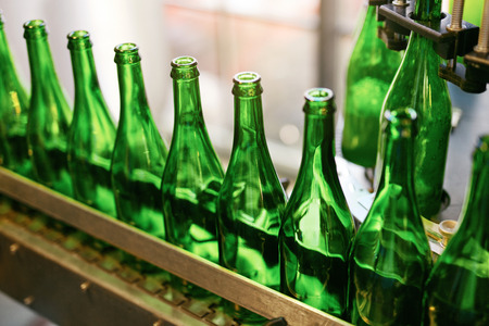 Beer Brewing Process On Brewery. Glass Bottles For Craft Beer On Conveyor. High Resolution