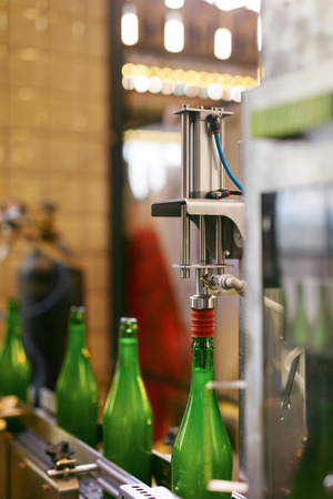 Beer Brewery. Craft Beer Manufacturing Process. Bottling Beer On Conveyor Line. High Resolution