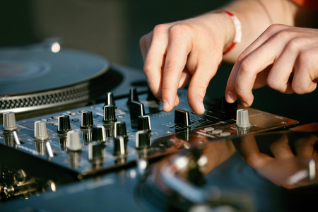 DJ Mixing Music Track On Festival. Deejays Hands On Professional Music Equipment Closeup. High Resolution