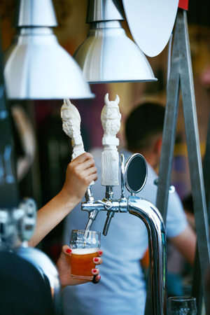 Beer Pub. Serving Beer In Glass At Bar. Bartender Hands Pouring Beer Into Glass. High Resolution Stok Fotoğraf