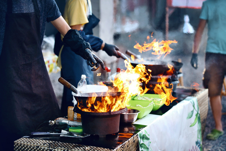 Cooking Food On Fire On Street Festival. Chef Cooking Thai Dish In Wok Outdoors. High Resolution Stock fotó - 108465524