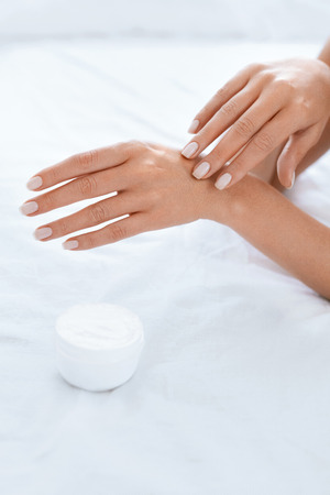Woman Hand With Cream. Closeup Of Applying Hand Lotion On Soft Silky Skin On Hands. Body Care. High Resolution Archivio Fotografico - 110706751