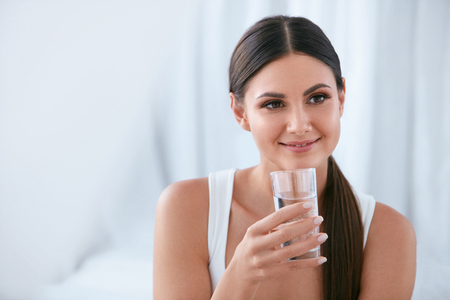 Happy Woman Drinking Water. Beautiful Smiling Young Female With Glass Of Fresh Water. High Resolution Stok Fotoğraf