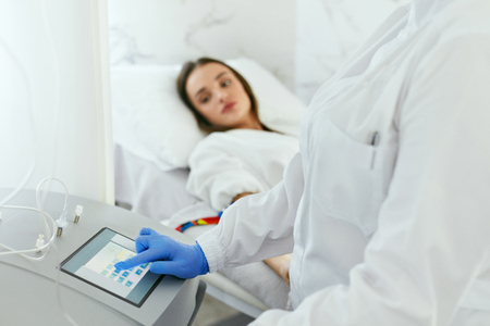 Blood Ozone Therapy. Woman At Blood Transfusion Treatment Or  Hemodialysis Procedure In Medical Clinic. High Resolution