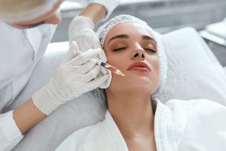Beauty Injections. Woman Getting Face Lifting Procedure Closeup, Cosmetology Injection At Clinic. High Resolution