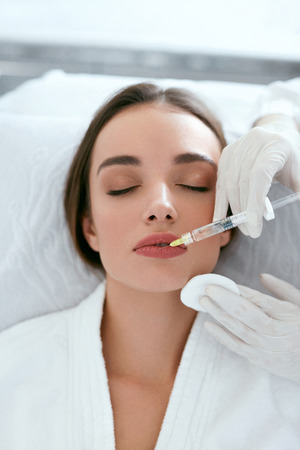 Lip Augmentation. Woman Getting Beauty Injection For Lips, Facial Beauty Procedure. High Resolution
