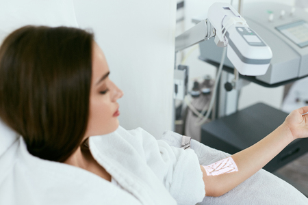Medical Procedure. Woman Scanning Veins With Vein Finder, Vein Mapping On Hand. High Resolution Stock fotó