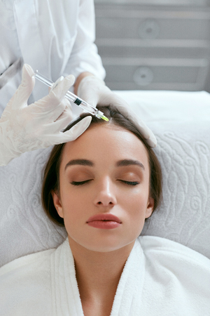 Mesotherapy For Hair Growth. Woman Receiving Injection In Head, Hair Loss Treatment. High Resolution