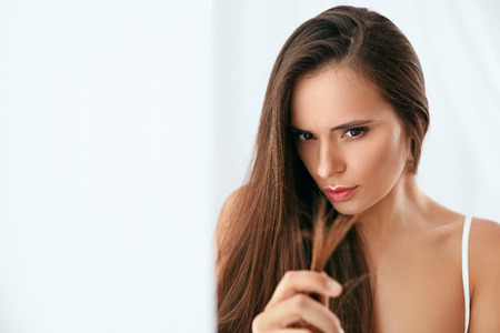 Dry Hair With Split Ends. Portrait Of Woman With Long  Damaged Hair. High Resolution