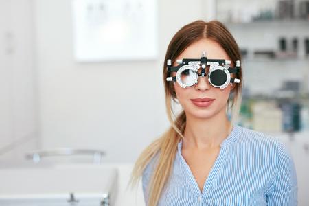 Eyesight Test. Woman In Optometrist Trial Frame At Optometry, Eye Examination. High Resolution Standard-Bild - 115593716