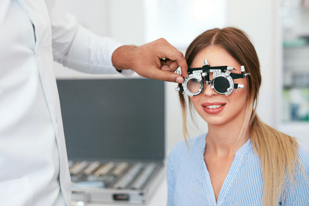 Eye Exam. Woman In Glasses Checking Eyesight At Clinic, Ophthalmology Examination. High Resolution Standard-Bild - 115593741