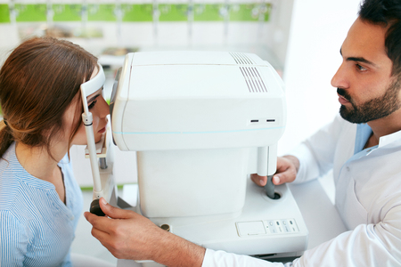 Eye Test. Optometrist Testing Woman Eyesight On Modern Equipment, Optometry Eye Exam. High Resolution