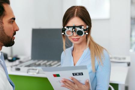 Ophthalmology Clinic. Eye Doctor Testing Woman Eyesight, Female In Optometry Glasses. High Resolution Standard-Bild - 115593746