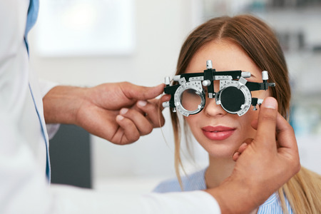 Eye Exam. Woman In Glasses Checking Eyesight At Clinic, Ophthalmology Examination. High Resolution