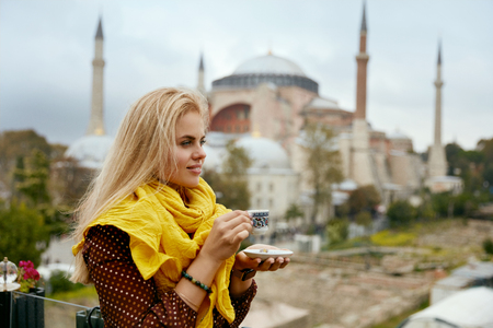 Woman Drinking Turkish Coffee With Mosque On Background, Female With Cup Of Drink In Hands. High Resolution
