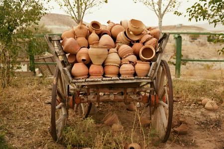 Pottery Jugs In Wooden Cartload, Handmade Ceramic Clay Crockery. Earthenware Pots In Cart Outdoors. High Resolution Stock fotó