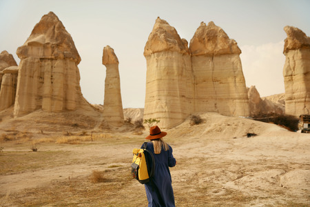 Travel. Woman Traveling At Stone Valley, Landscape Of Love Valley, Famous Turkey Landmark. High Resolution Stock Photo