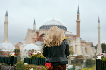 Travel. Woman Near Mosque Traveling To Turkey, Standing Near Hagia Sophia Cathedral On Background. High Resolution