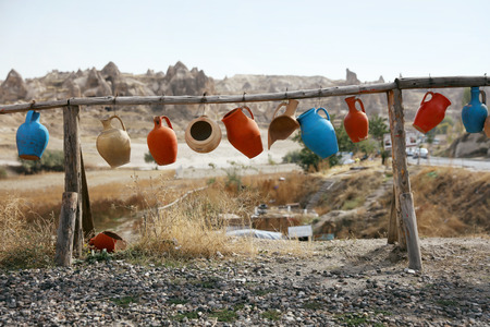 Countryside. Colorful Old Jugs Hanging In Yard, Broken Clay Jars Outdoors. High Resolution